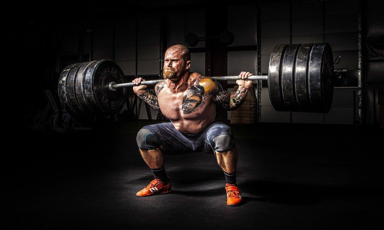 Picture of a man lifting weights